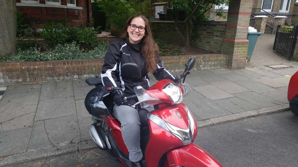 Rachel on her scooter